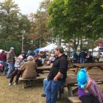 Carbon County Oktoberfest attendees enjoying festivals on grounds.