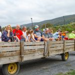 Crowd of people taking hayride at Carbon County Oktoberfest