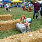Little redhead girl keg rolling.