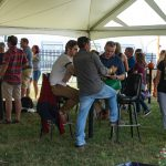 Crowd drinking beer under tent at Carbon County Oktoberfest