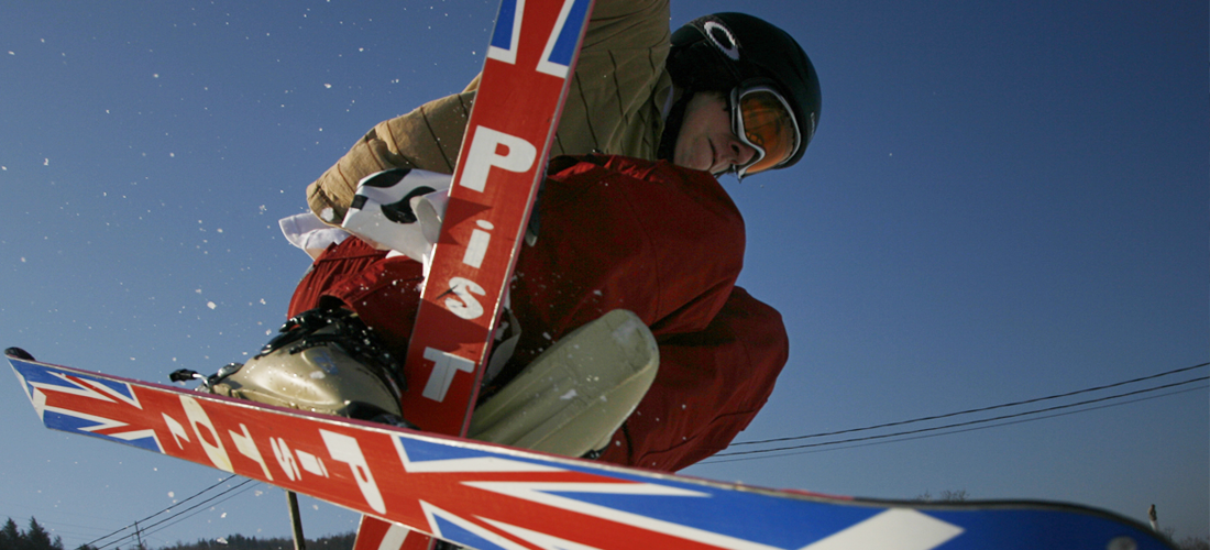 Man doing a jump while skiing.