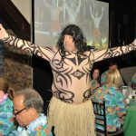 Another island man dancing at the CCEDC Hawaiian Luau Awards Gala