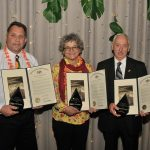 Three award winners at the CCEDC Hawaiian Luau Awards Gala.