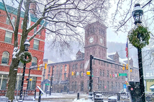 Shot of clocktower in downtown Jim Thorpe on snowy day.