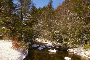 Winter river scene with snow in Carbon County state park.
