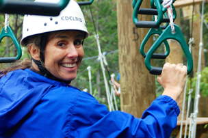 Woman in blue jacket ziplining