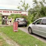Cars entering gate of Mahoning Drive-in