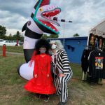 Man dressed as Beetlejuice with doll dressed up