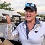 Marlyn Kissner standing next to golf cart