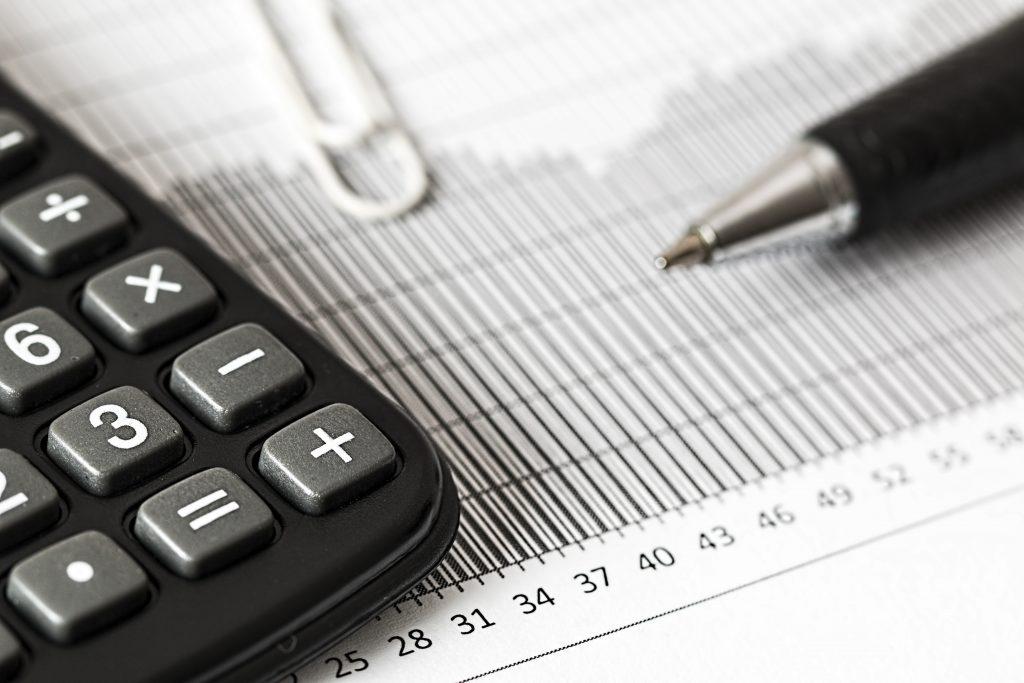 calculator spreadsheet and pen
