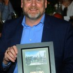 State Representative Doyle Heffley holding award