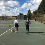 Two women on the tennis court