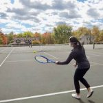 Kiya Jenkins playing tennis on the court