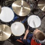 Drummer playing drums birdseye view