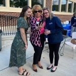 Maureen Donovan posing with two Leadership Carbon Class of 2021 grads