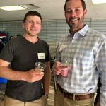 Two male guests drinking wine at Wine & More on 1st ribbon cutting