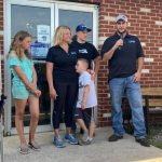 Shoenberger's Meat Market owner and family speaking to guests at ribbon cutting