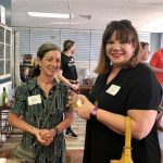 Two female guests at Wine & More on 1st ribbon cutting