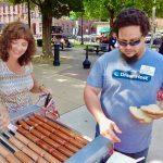 Guests at hotdog stand at trolley opening