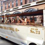 People waving on the white Jim Thorpe trolley