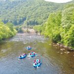 Four whitewater rafters in river