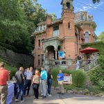 Guests outside Harry Packer Mansion