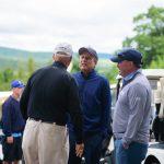 Three golfers talking