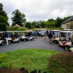 Golf carts with golfers ready to go