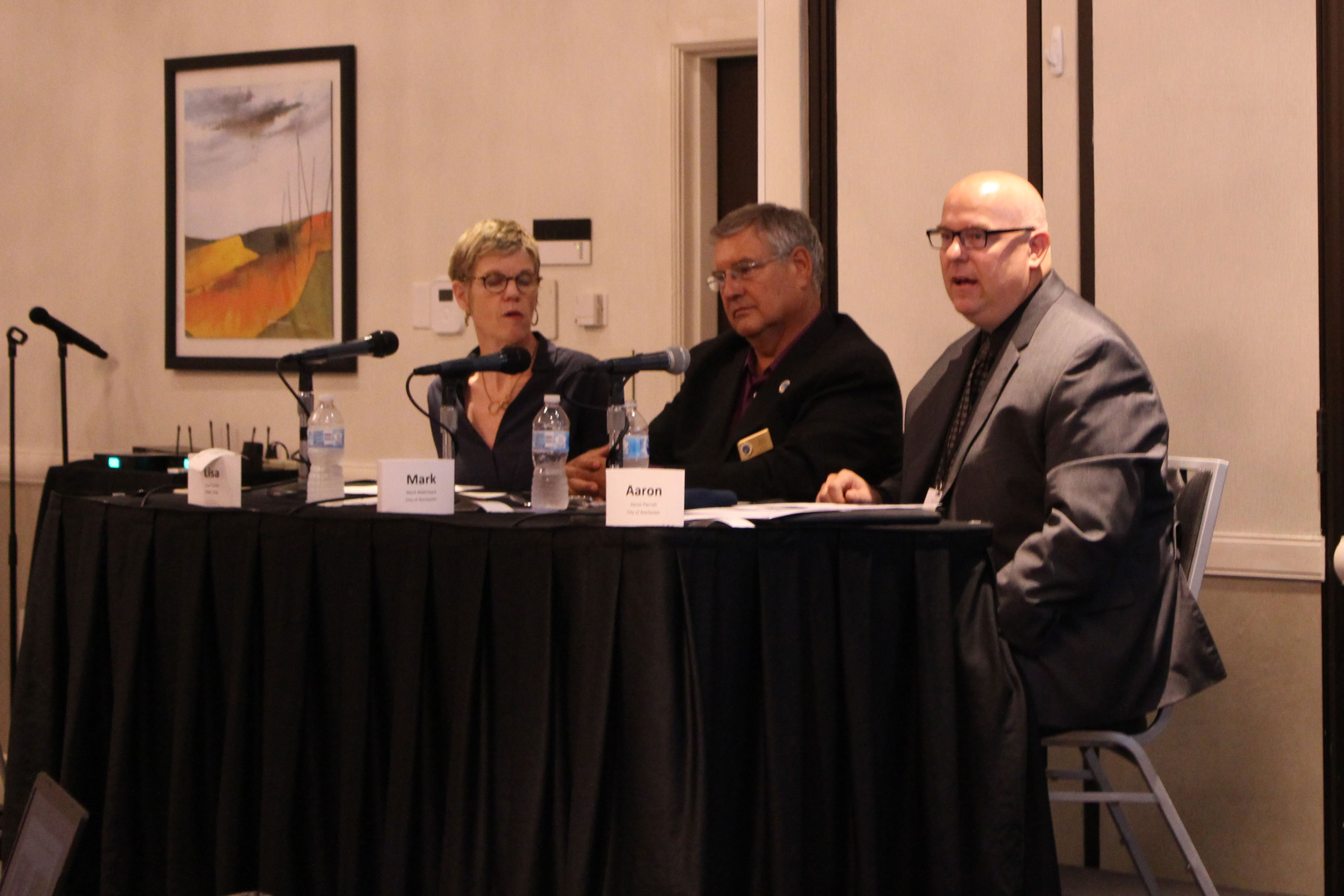 From left: DMC Executive Director Lisa Clarke, City Councilmember Mark Bilderback, and Assistant City Administrator Aaron Parrish