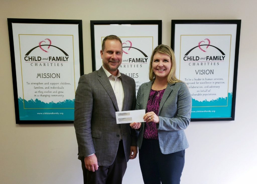 Matt Resch handing Leadership Lansing check to Lansing-based nonprofit Child and Family Charities