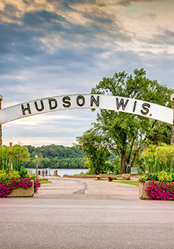 hudson wis. arch sign over road to park