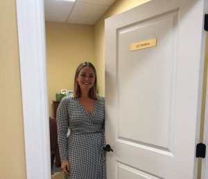 Lindsey Cumoletti owner of LGC Nutrition outside her office