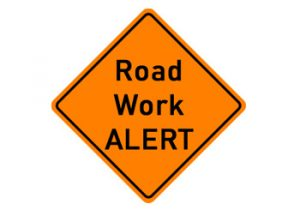 orange construction sign with text Road Work Alert