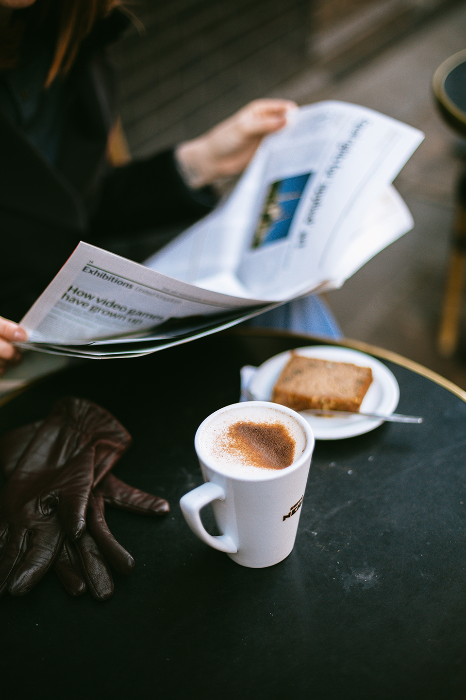 Canva - Person Having a Coffee and Reading a Newspaper