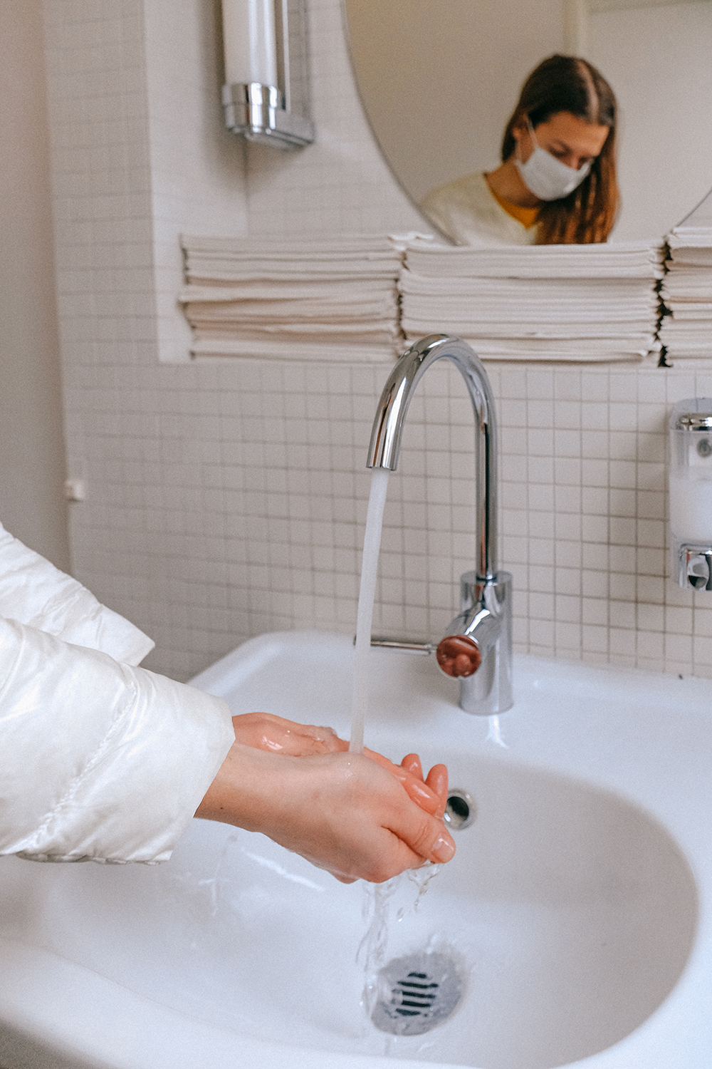 Canva - Woman With a Face Mask Washing her Hands