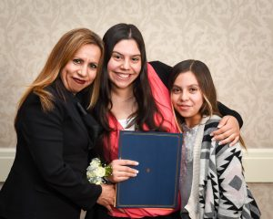 Jazmin Santiesteban (center) with mother, Maria and sister, Iris
