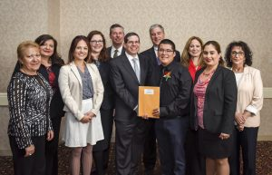 Student Honoree Christopher Ibarra (4th from right) with First Bank of Highland Park President and COO, Eric Ephraim (center) and bank representatives