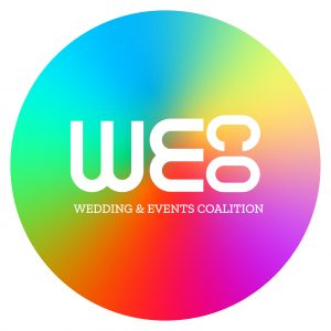 Rainbow Color Circle with WE horizontal in large letters and C O in smaller letters running virtually along the side with wedding and events coalition under the letters