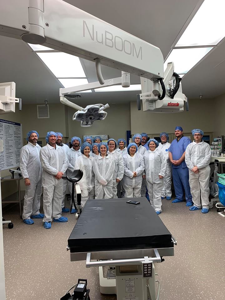 group photo in hospital surgical room