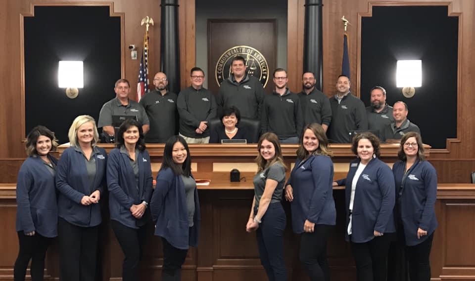 group shot of leadership members in court room