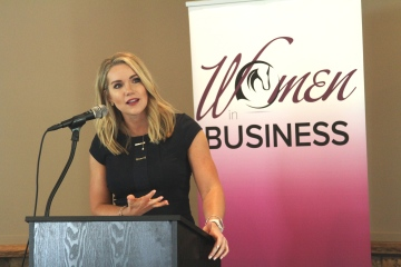 woman-at-podium-women-in-business