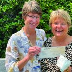 Laura Gingrass from Monadnock Community Hospital hands over a GKPC check to Ellen Avery from the Volunteer Transportation Company, who MCH chose to receive 50% of their charity golf sponsorship!