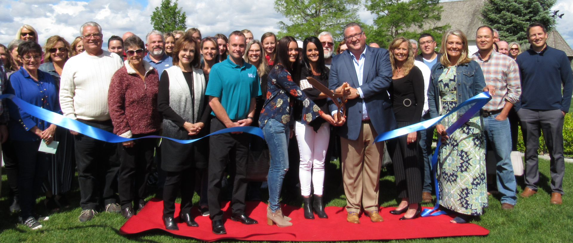 Ambassadors attending a ribbon cutting
