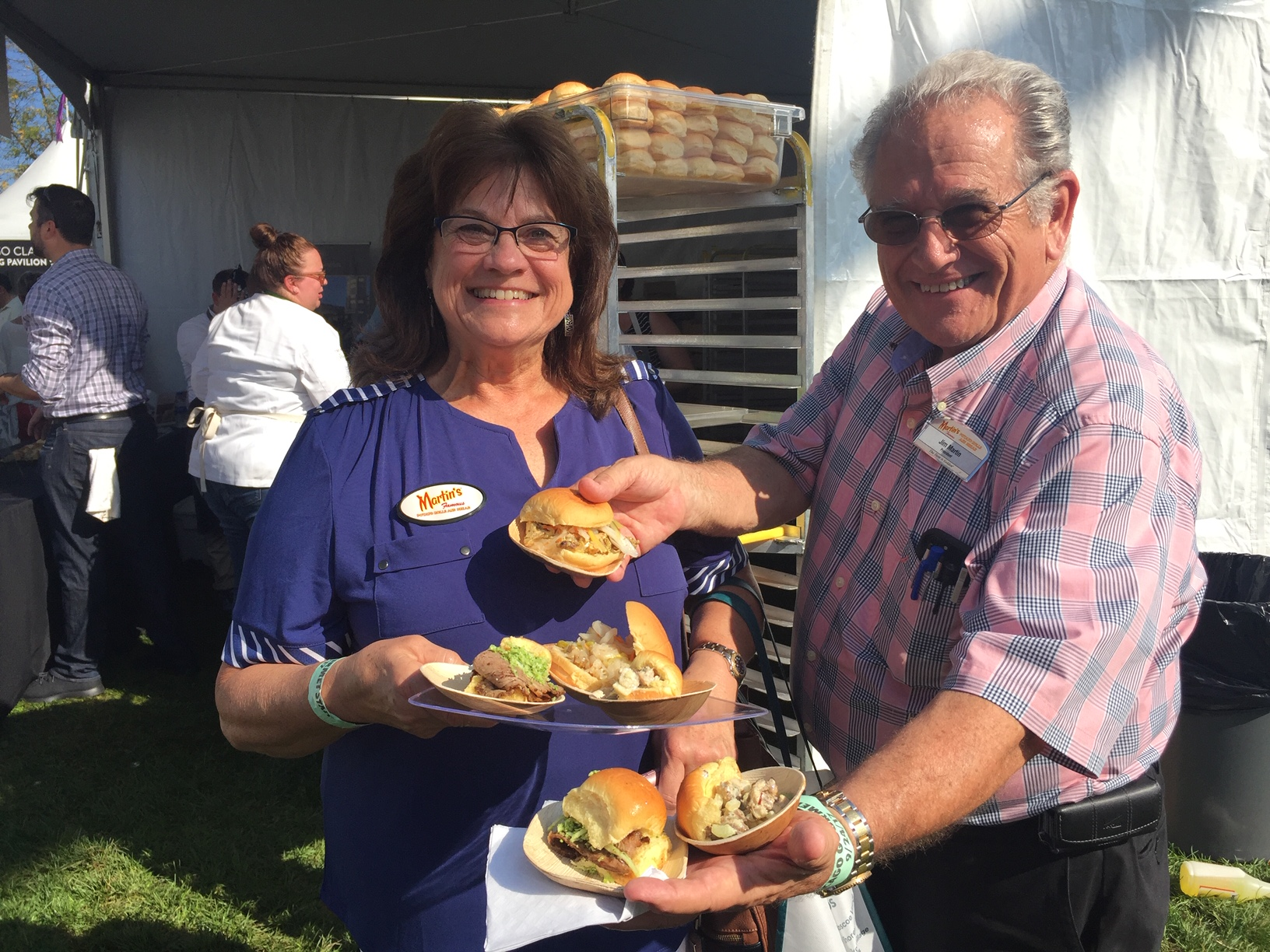 Jim_with_his_wife_Donna_serving_sandwiches_with_Martin's_Potato_Rolls