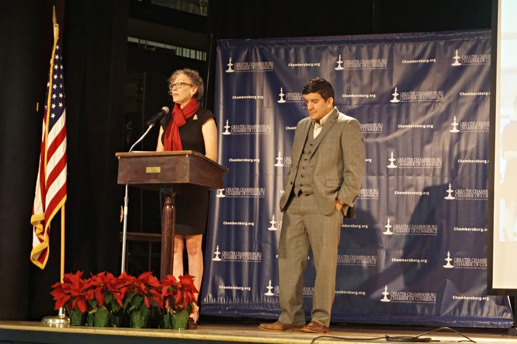 Mike Kalathas receiving the award from Kim Crider