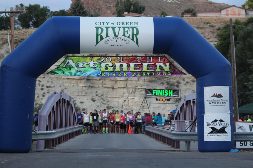 finish line with city of green river logo and runners