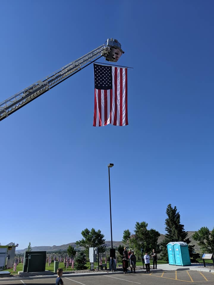 flag high in the air on fire truck