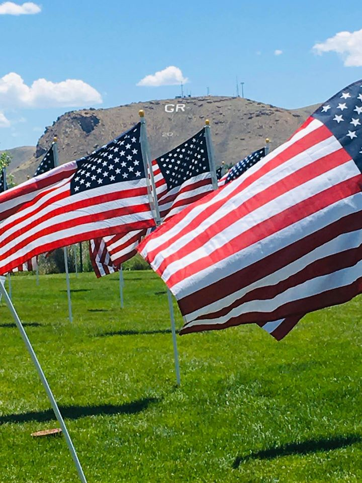 flags with GR in the background