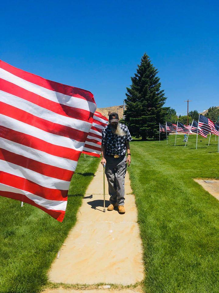 veteran walking flags of honor