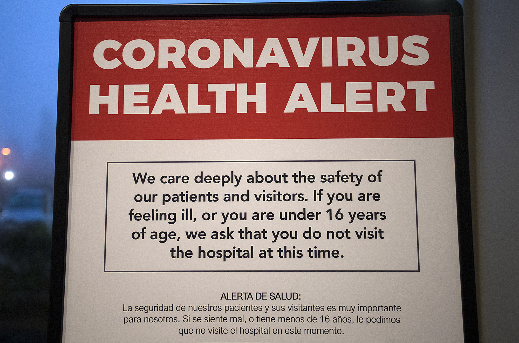 A coronavirus health alert sign is posted at one of the entrances to the Firstenburg Tower at PeaceHealth Southwest Medical Center on Monday morning, March 9, 2020. (Amanda Cowan/The Columbian)